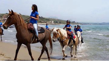 Horseback Riding (& Surfing) on the Beach...